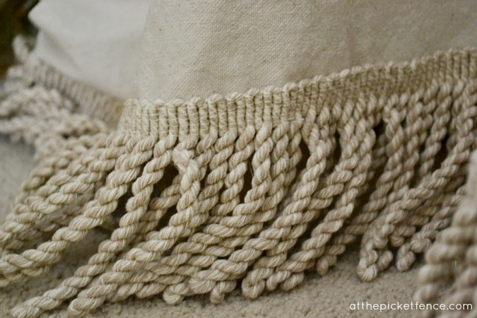 Add bullion fringe to a drop cloth table skirt At the Picket Fence