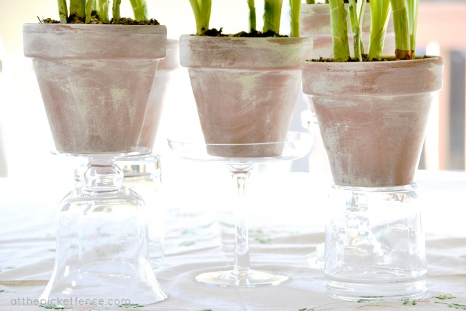 pots on glass stands at the picket fence