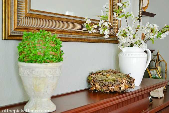 Spring Mantel with forced branches www.atthepicketfence.com