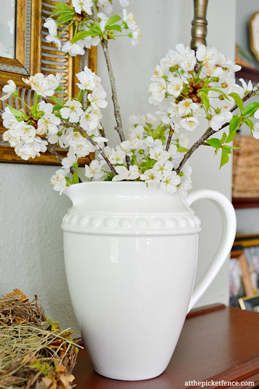 cherry blossoms in white pitcher www.atthepicketfence.com