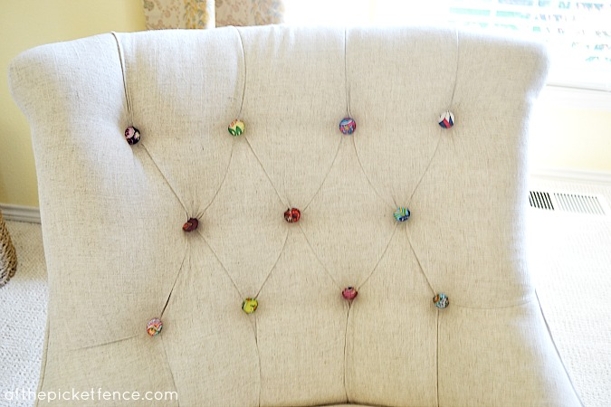 fabric covered button tufted chair www.atthepicketfence.com