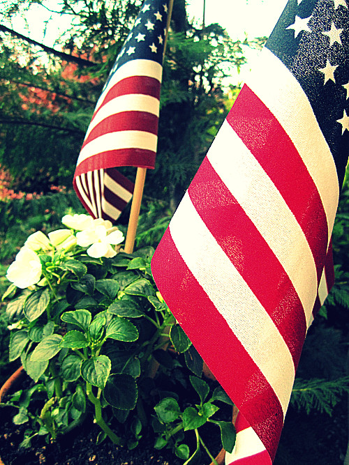 American flags on stacked pot victory garden atthepicketfence.com
