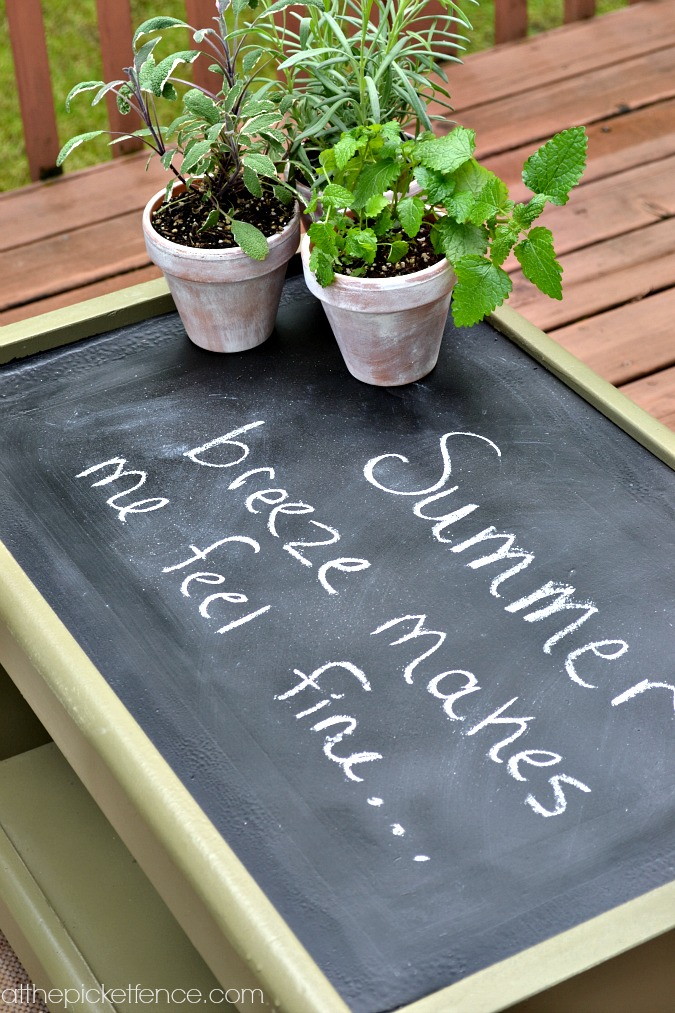 chalkboard topped outdoor coffee table www.atthepicketfence.com