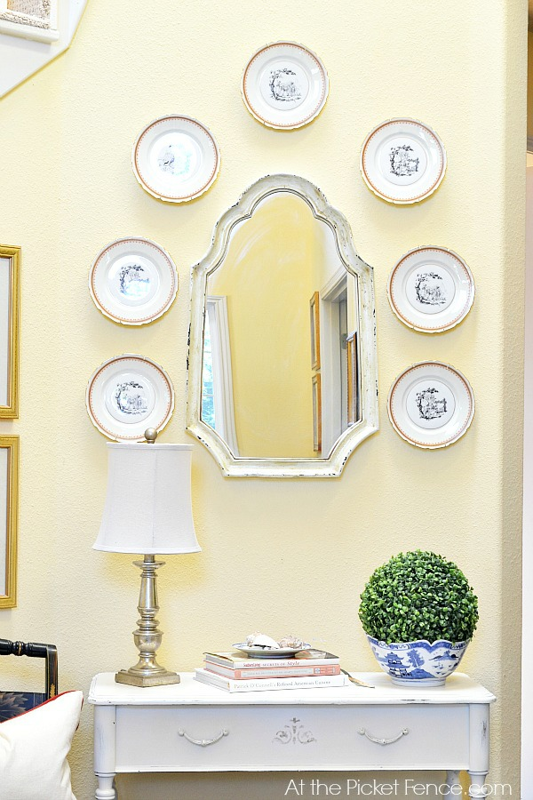 console_table_in_entry_with_mirror_and_plates atthepicketfence.com