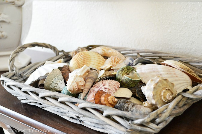 basket filled with seashells atthepicketfence.com
