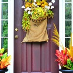 Fall front door arrangement in burlap sack
