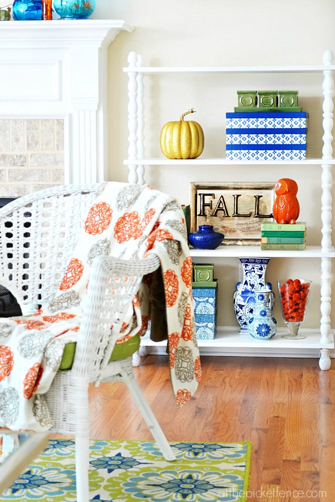 blue gold and orange fall touches on bookcase