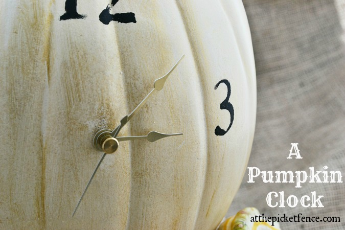 clock-face-on-fake-pumpkin from atthepicketfence.com