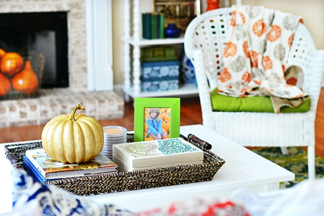 fall coffee table with gold pumpkin