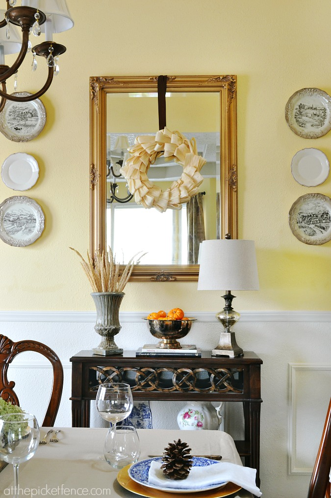 Fall dining room with corn husk wreath from atthepicketfence.com