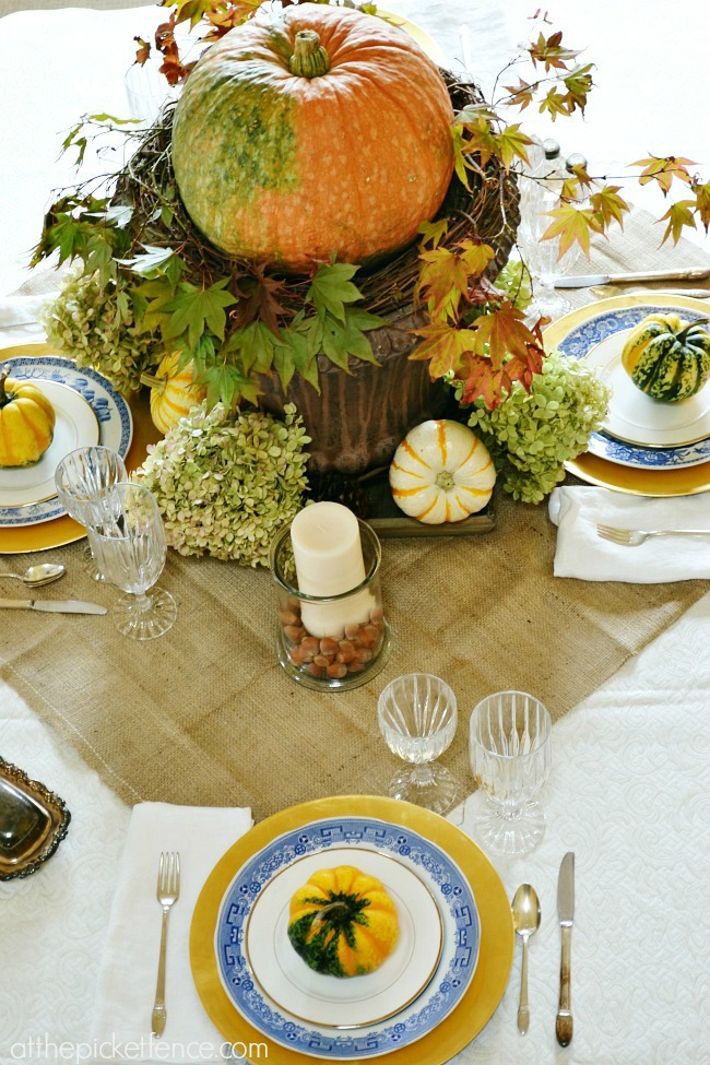 Fall dining room table setting and centerpiece decor ideas from atthepicketfence.com