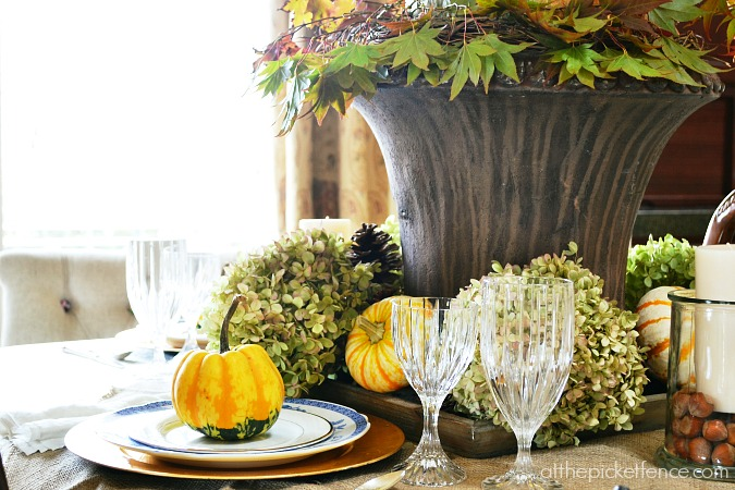 Fall dining room tablescape from atthepicketfence.com