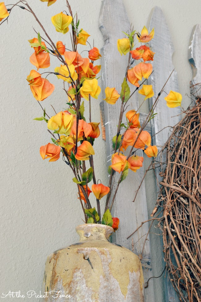 Fall foliage in an urn for simple fall decorating from atthepicketfence.com