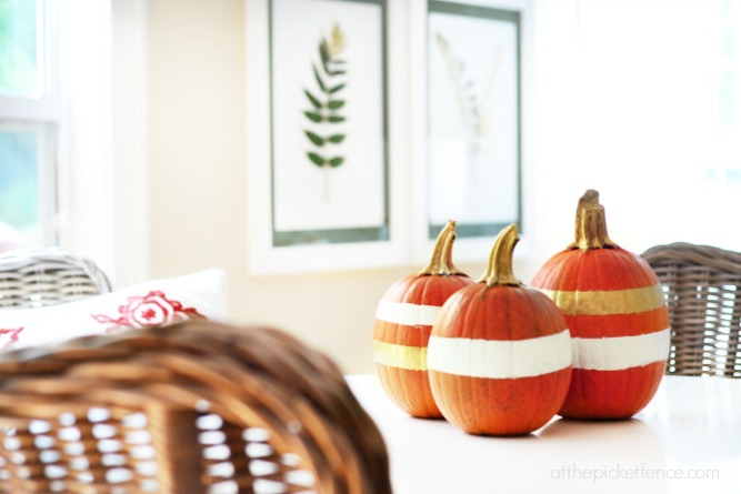 gold and white striped pumpkins with gilded stems