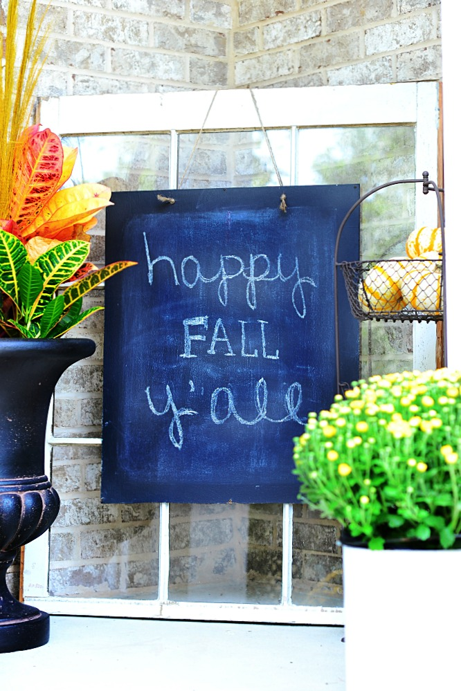 happy fall yall chalkboard sign on window