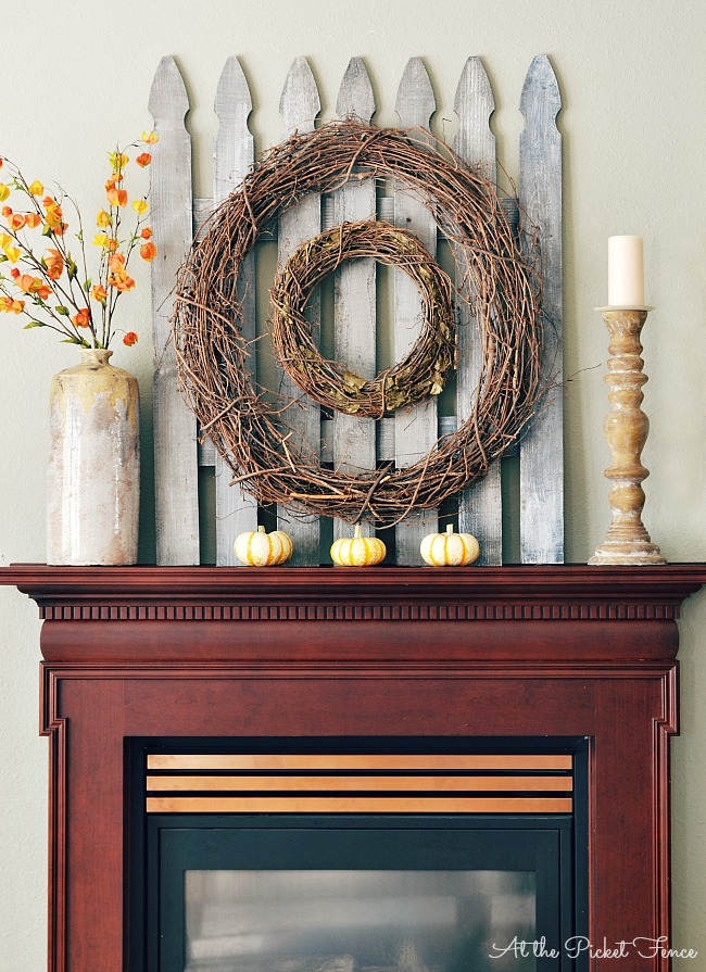 Decorating a mantel for fall using a picket fence from atthepicketfence.com