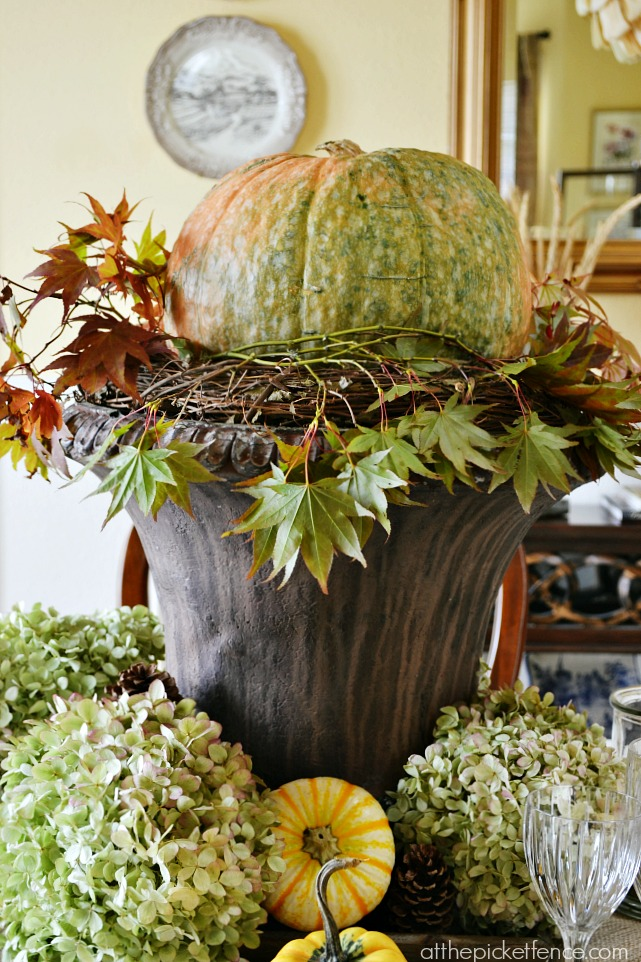 Pumpkin in urn fall dining room centerpiece from atthepicketfence.com
