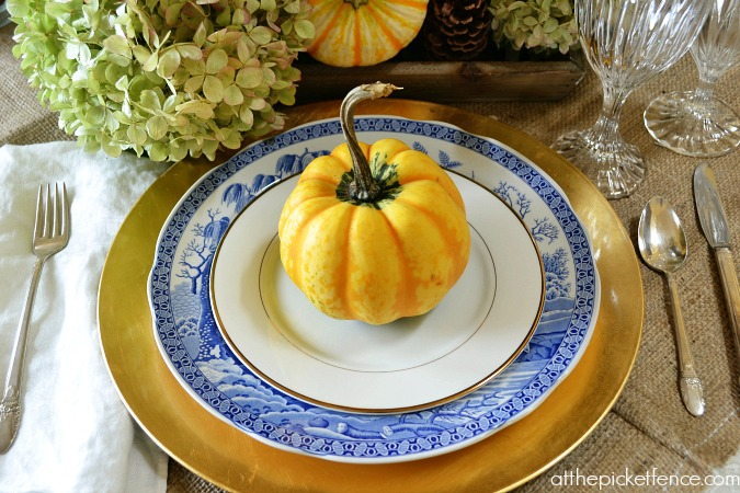 Fall pumpkin place setting from atthepicketfence.com
