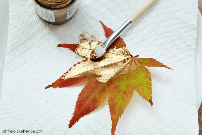 applying gold liquid gilding to leaf