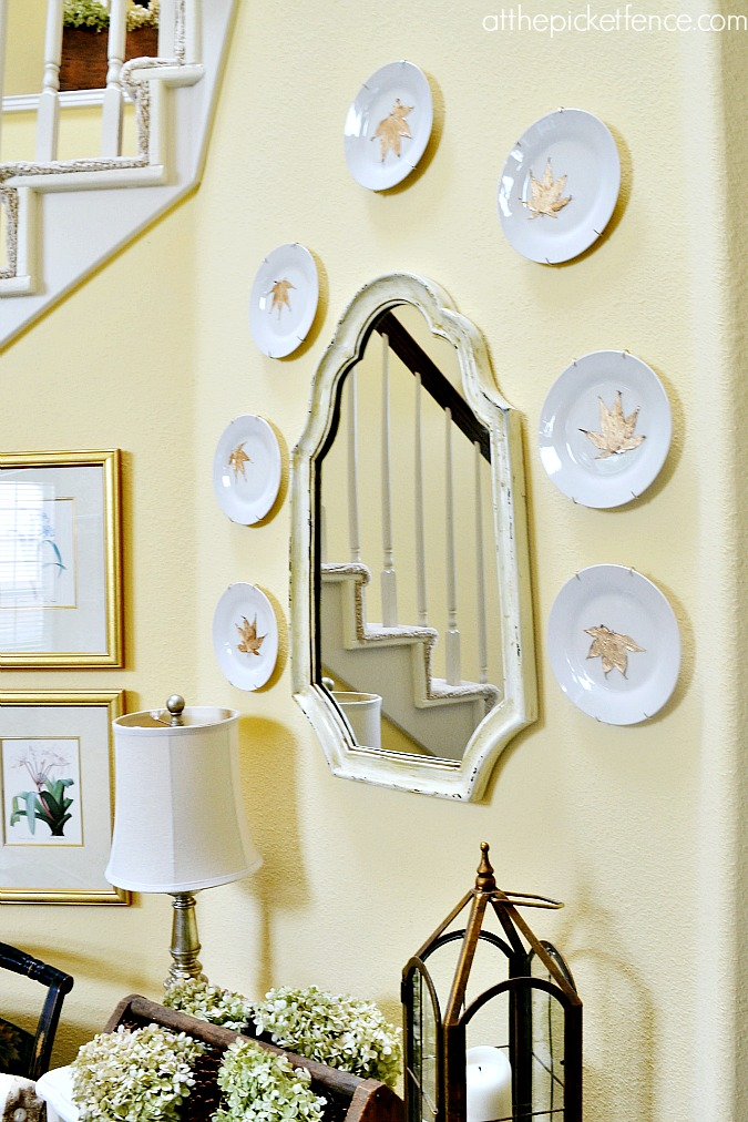 gilded gold leaf plates around mirror from atthepicketfence.com