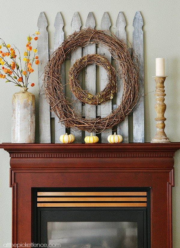 Fall Mantel with DIY picket fence backdrop from atthepicketfence.com