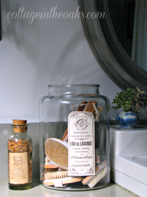 Cottage In The Oaks apothecary jars in cottage bathroom
