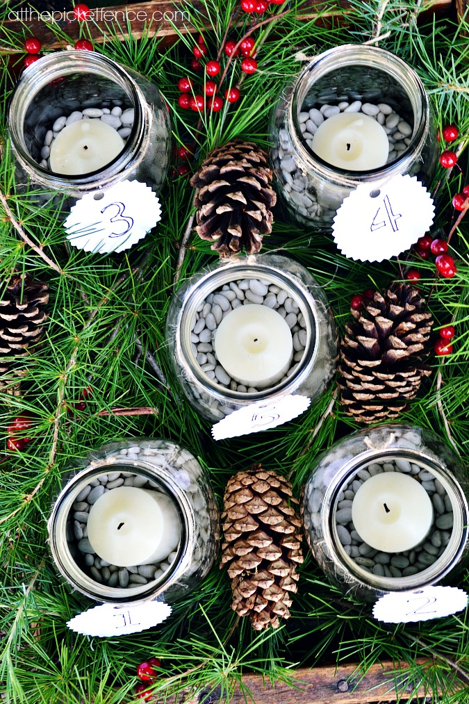 mason jars with beans and candles for advent calendar