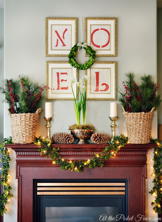 Christmas mantel with boxwood garland from atthepicketfence.com