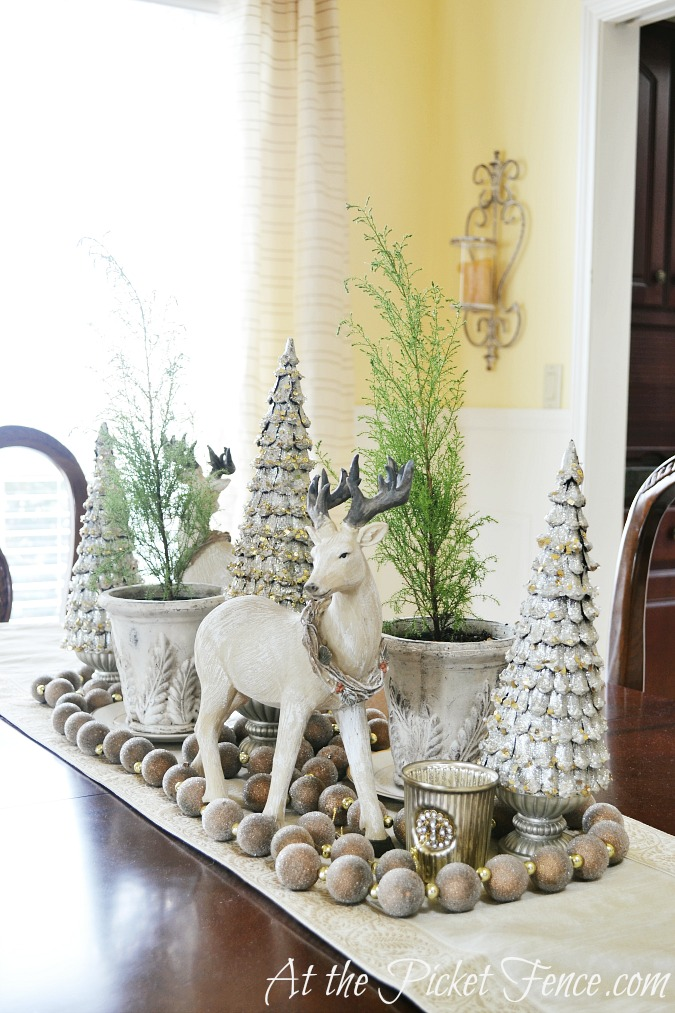 Dining room table winter or Christmas decor from atthepicketfence.com