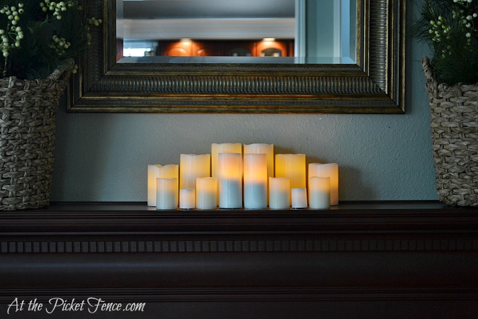 battery operated candles clustered on mantel