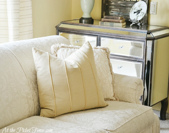 butter yellow pillow on cream sofa