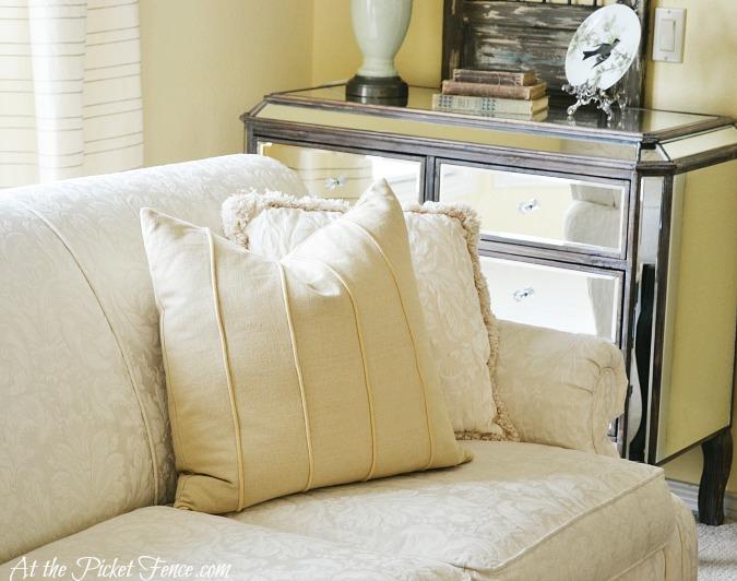 butter yellow pillow on cream sofa