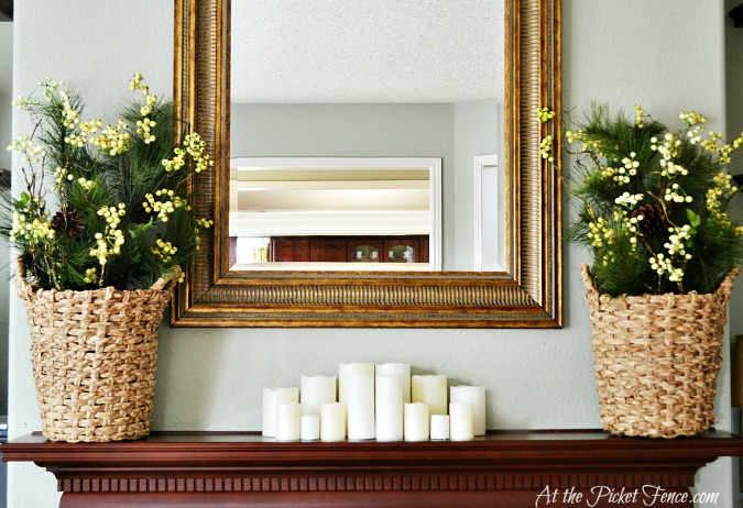 winter mantel decorating with baskets and candles from atthepicketfence.com