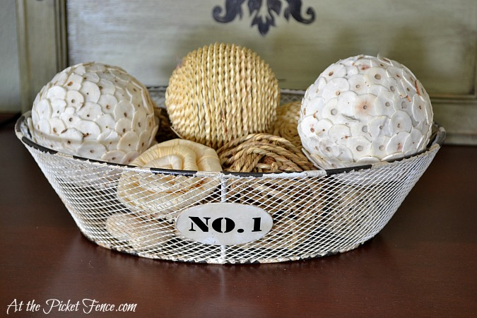 wire basket with winter decor