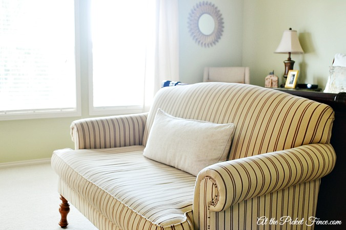 striped settee at foot of bed