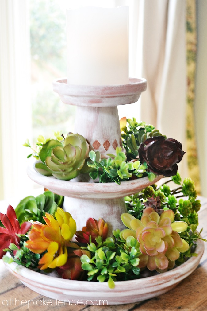 two tiered clay pot stand with succulents atthepicketfence.com