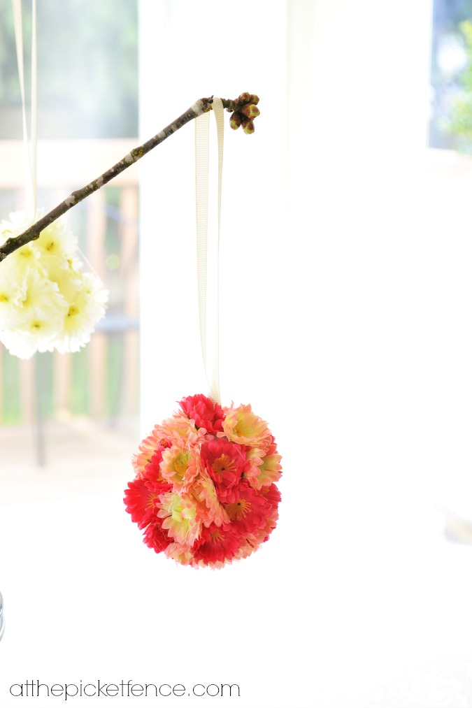flower covered egg hanging on branch atthepicketfence.com