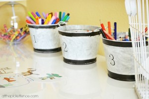 galvanized buckets on art desk