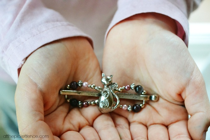 hands holding lilla rose hair clip