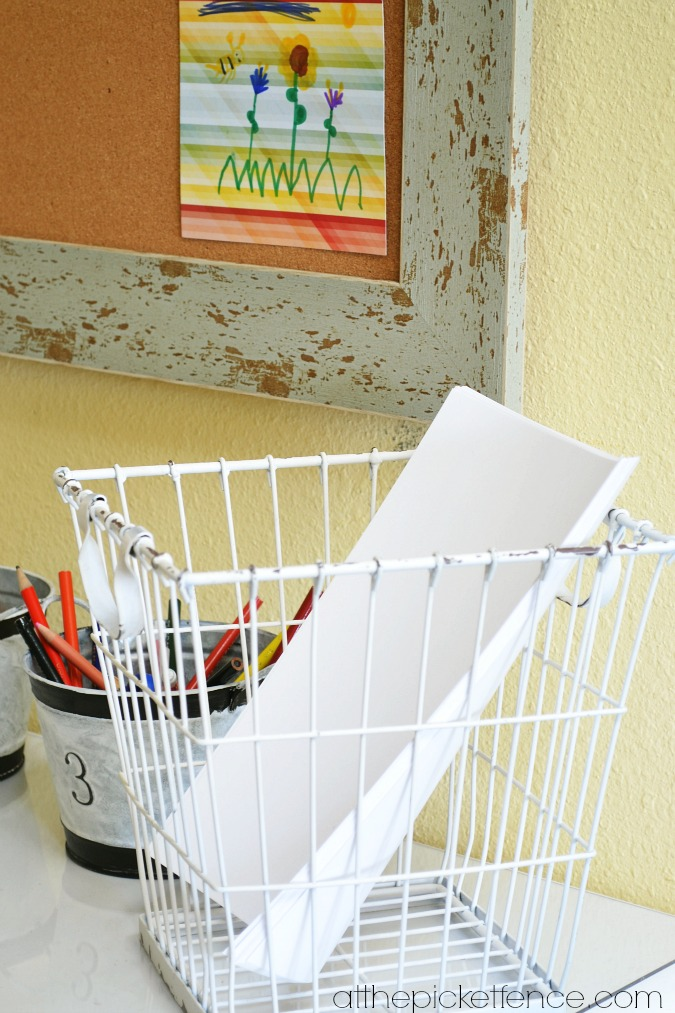 wire basket with paper on art desk