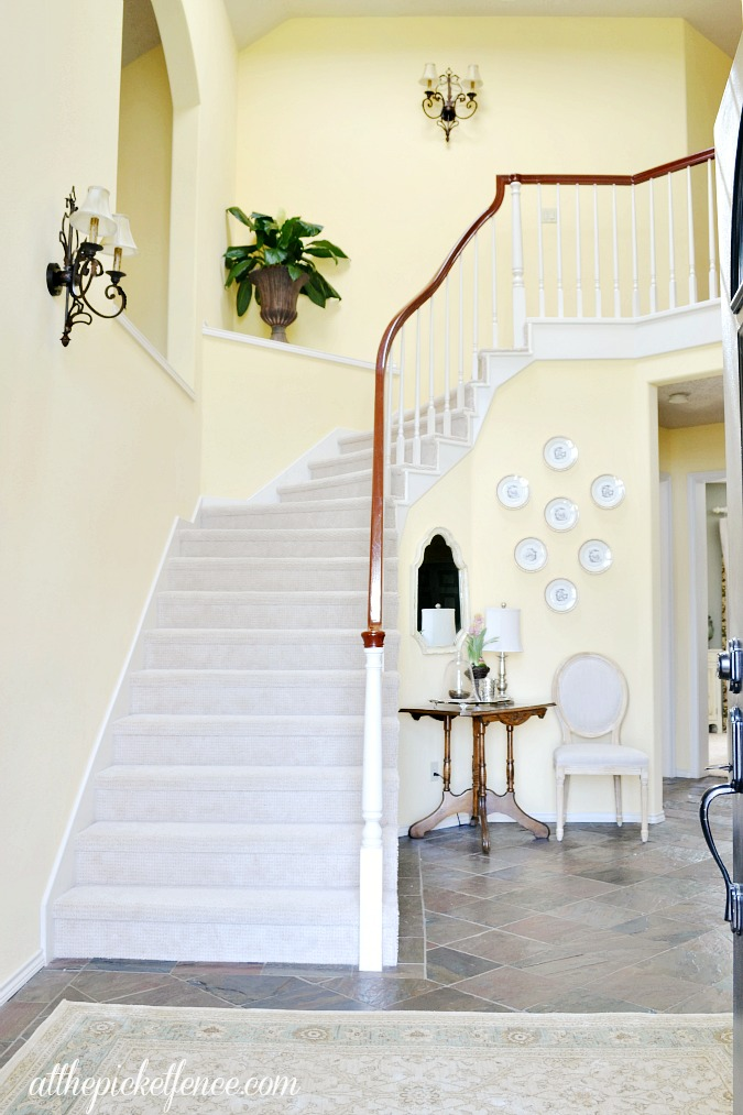Traditional entry with curved staircase atthepicketfence.com