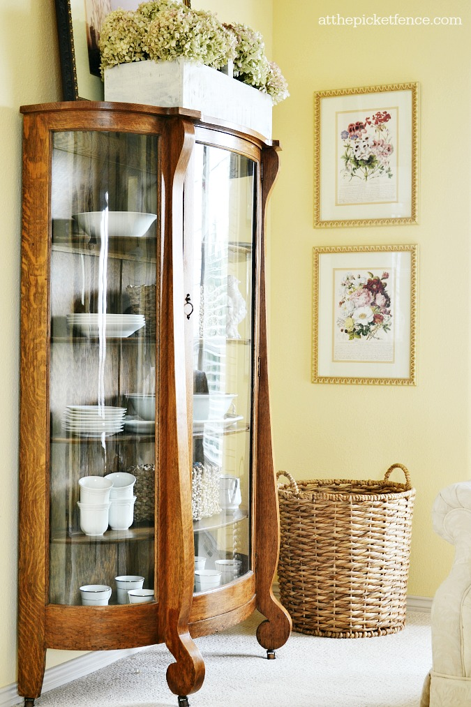 antique china cabinet in living room