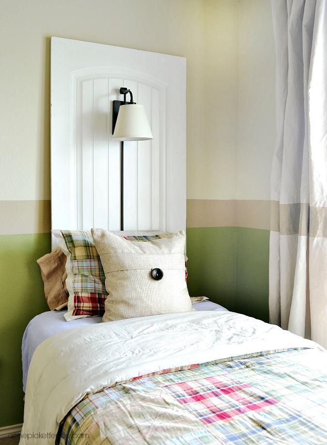 door turned headboard with wall lamp