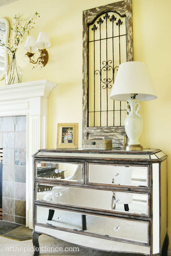 mirrored dresser on sides of fireplace