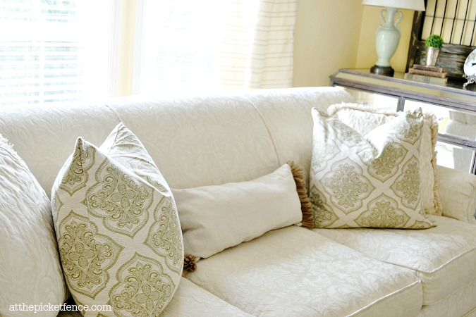 pillows on off white damask sofa