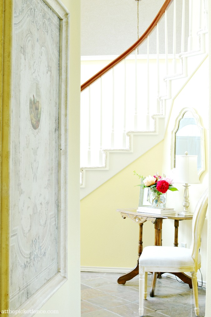 French country entry with curved staircase atthepicketfence.com