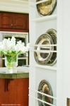 plate rack on wall in kitchen atthepicketfence.com