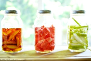 fruit infused liquor in jars atthepicketfence.com