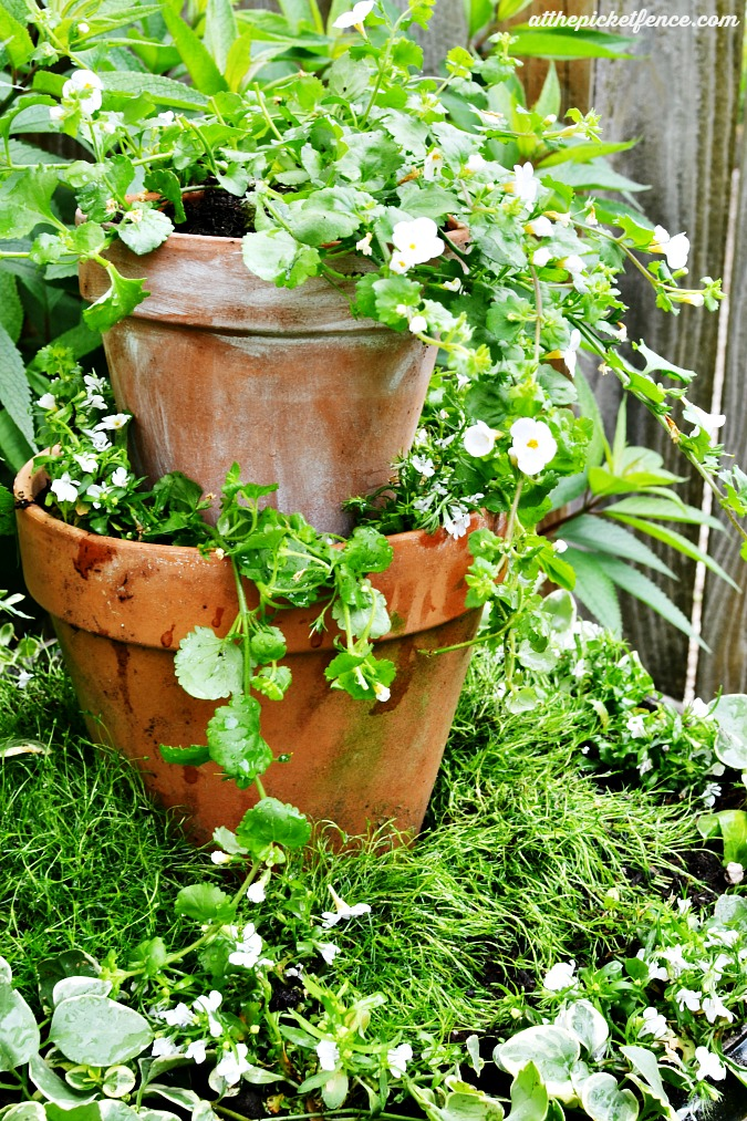 tiered outdoor fountain turned garden planter atthepicketfence.com