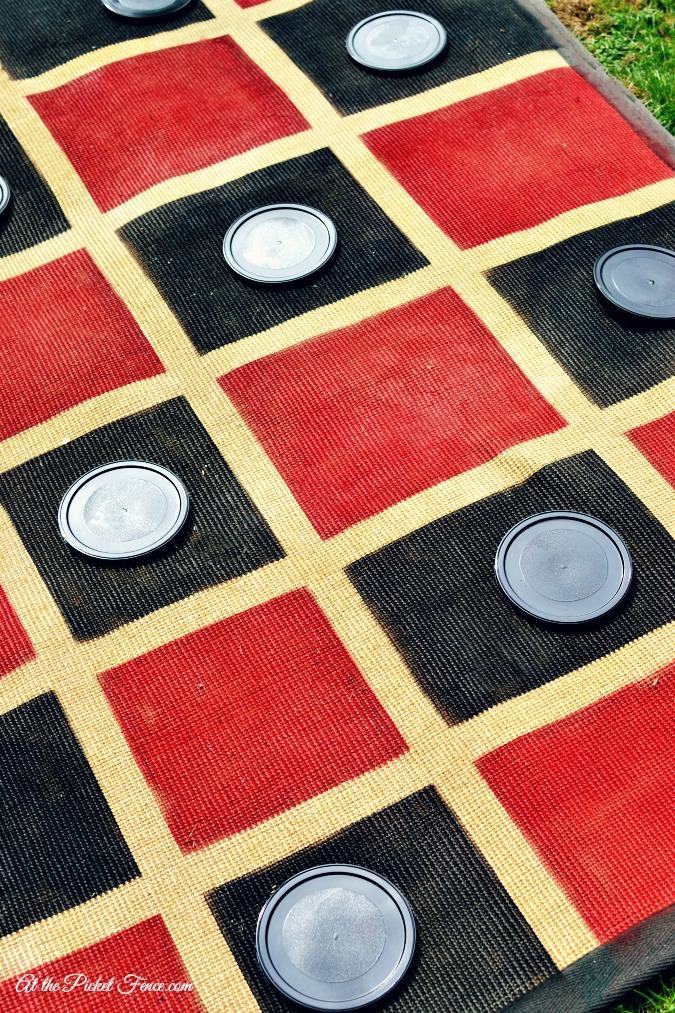 paint can lids as checkers for outdoor checkers game